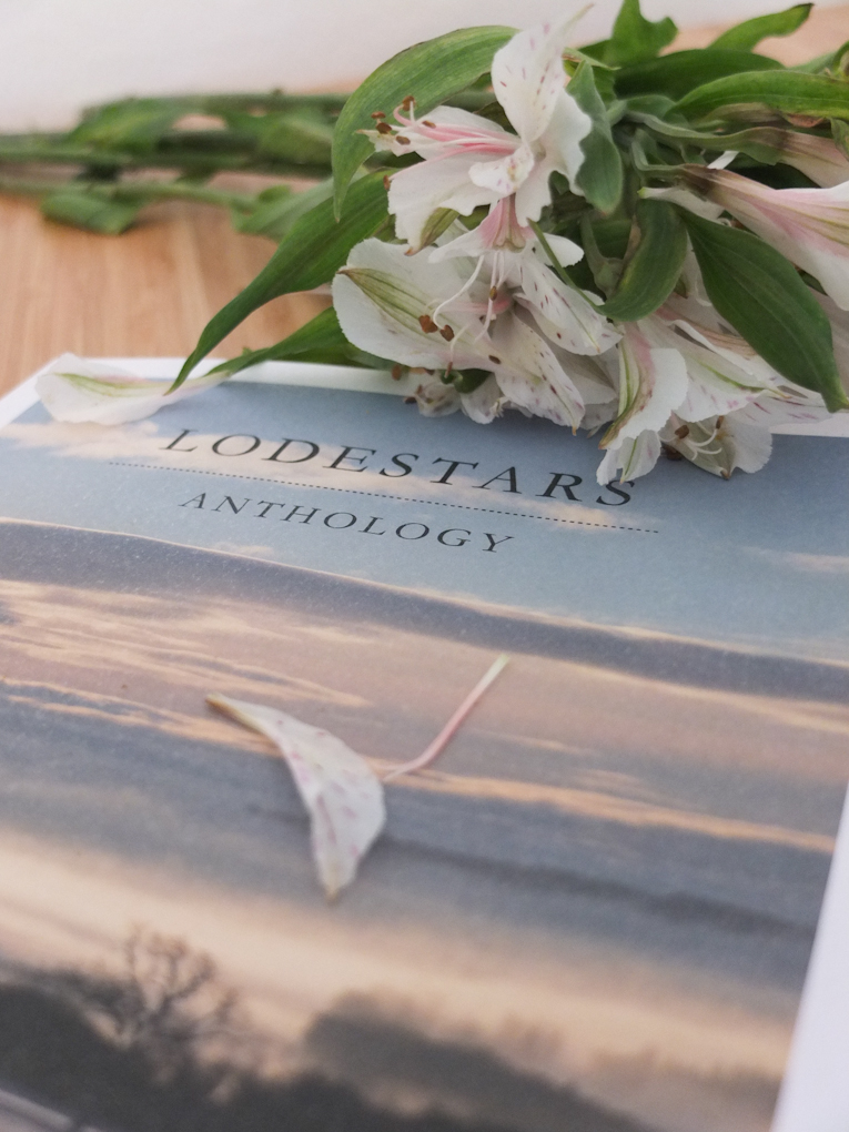 Lodestars Anthology front cover and flowers