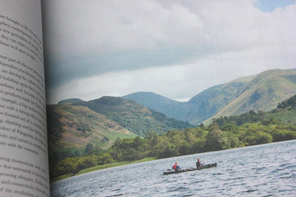 People rowing boat infront of hills in Another Escape magazine