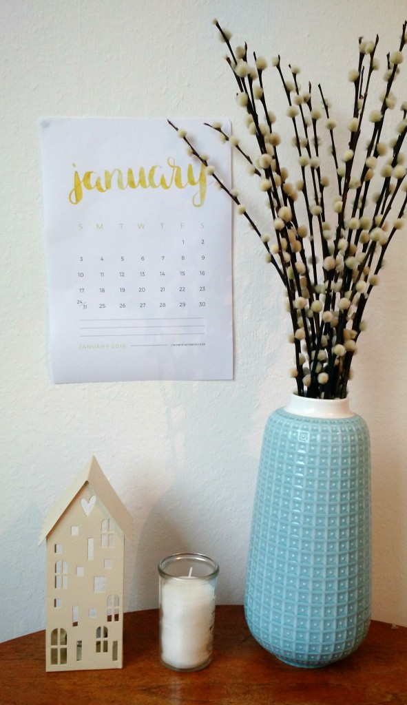 January calendar with blue vase on table