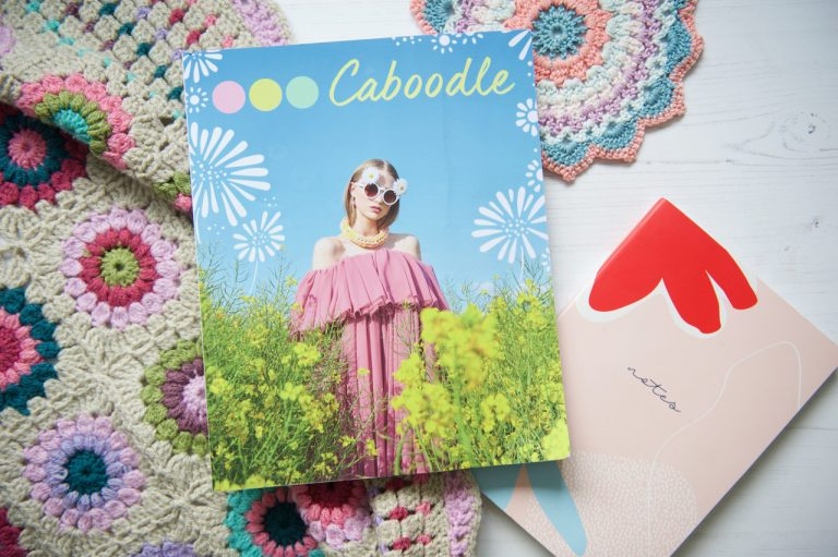 Caboodle Magazine flatlay of front cover with crochet and notebook