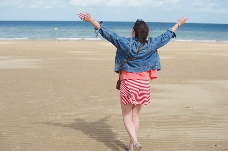 On Margate beach, arms in the air