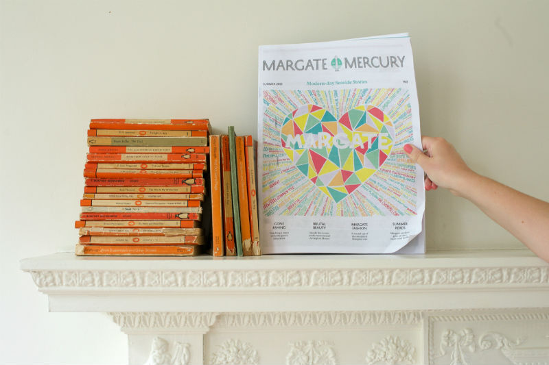 Margate Mercury newspaper with hand holding it on mantlepiece