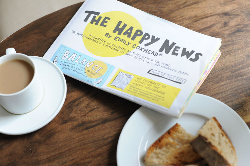 The Happy News independent magazine newspaper with tea and toast