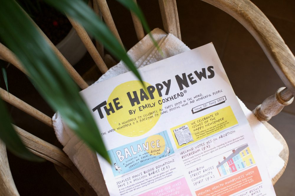 The Happy Newspaper with plant on chair