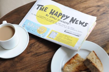 The Happy Newspaper with tea and toast
