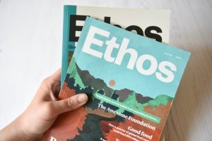 Ethos magazine issue 5 and 6 closed and held in hand