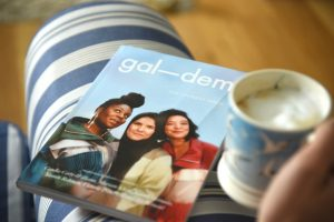 Gal-dem UN/REST magazine cover with coffee cup on arm of chair